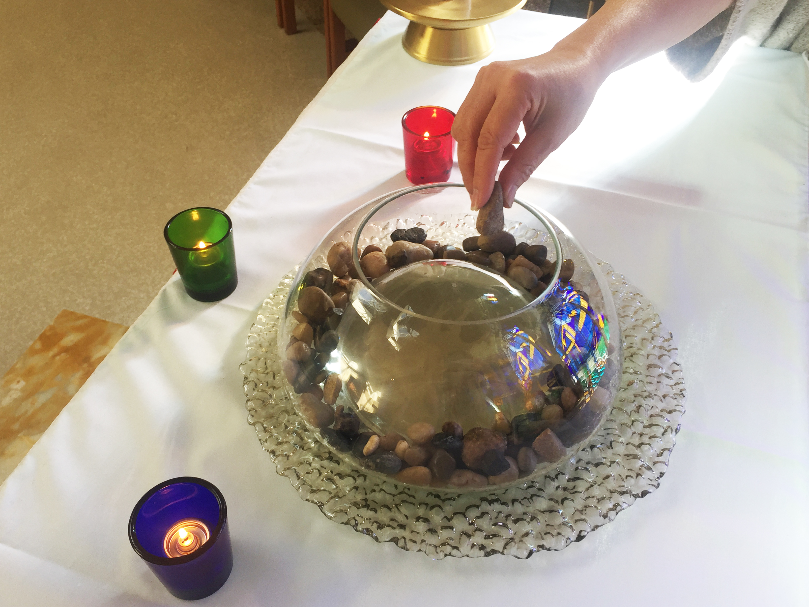 Placing a rock in a vessel of water symbolizes the ripple effect of someone's life. It's one way staff at St. Vincent's: Langara may choose to honour the deceased.