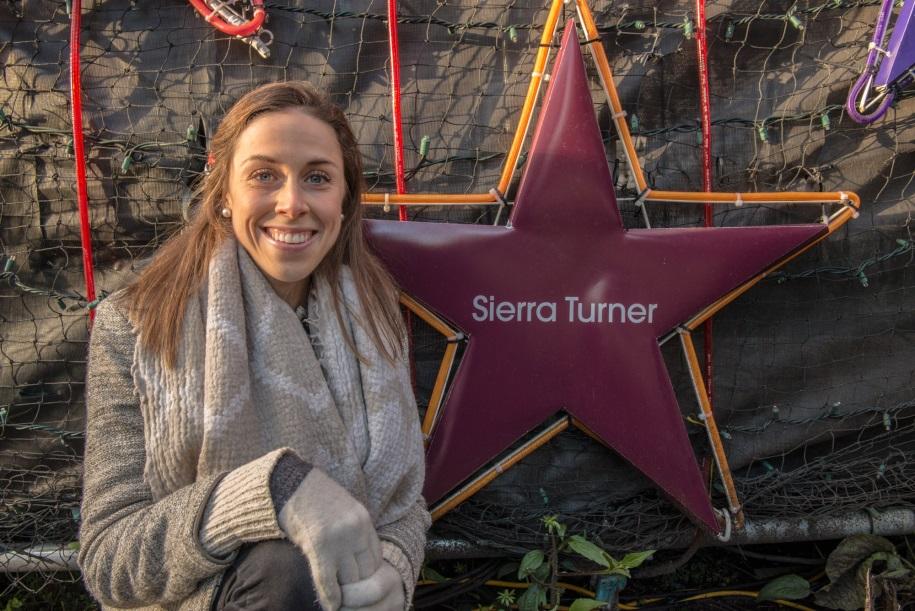Photo of Sierra Turner in front of Light of Hope star at St. Paul's Hospital