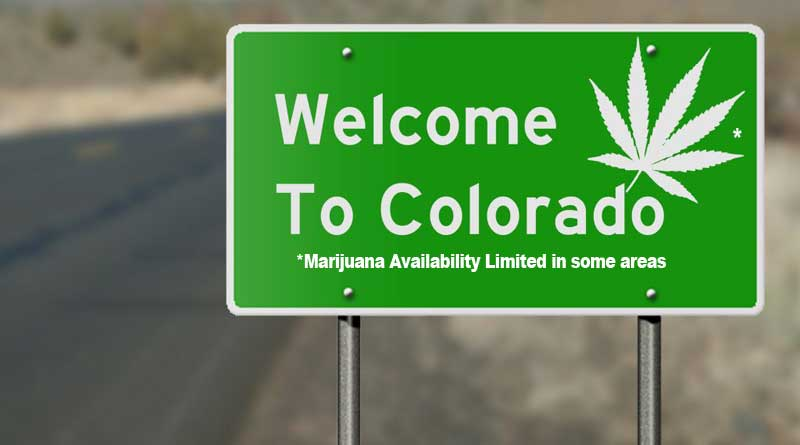 """Welcome to Colorado"" sign with marijuana leaf."