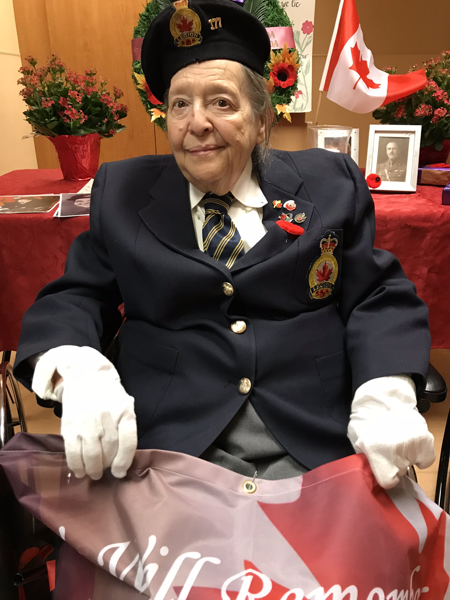Royal Canadian Air Force veteran Colleen de Serres sitting with flag in her lap.