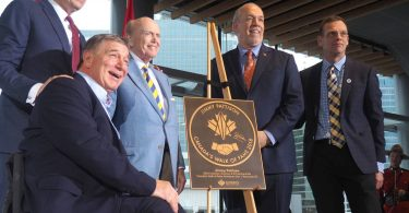 Vancouver legend Rick Hansen (second from left) joined Jim Pattison (centre) when the billionaire businessman was inducted into Canada's Walk of Fame. Photo courtesy of the Georgia Straight.