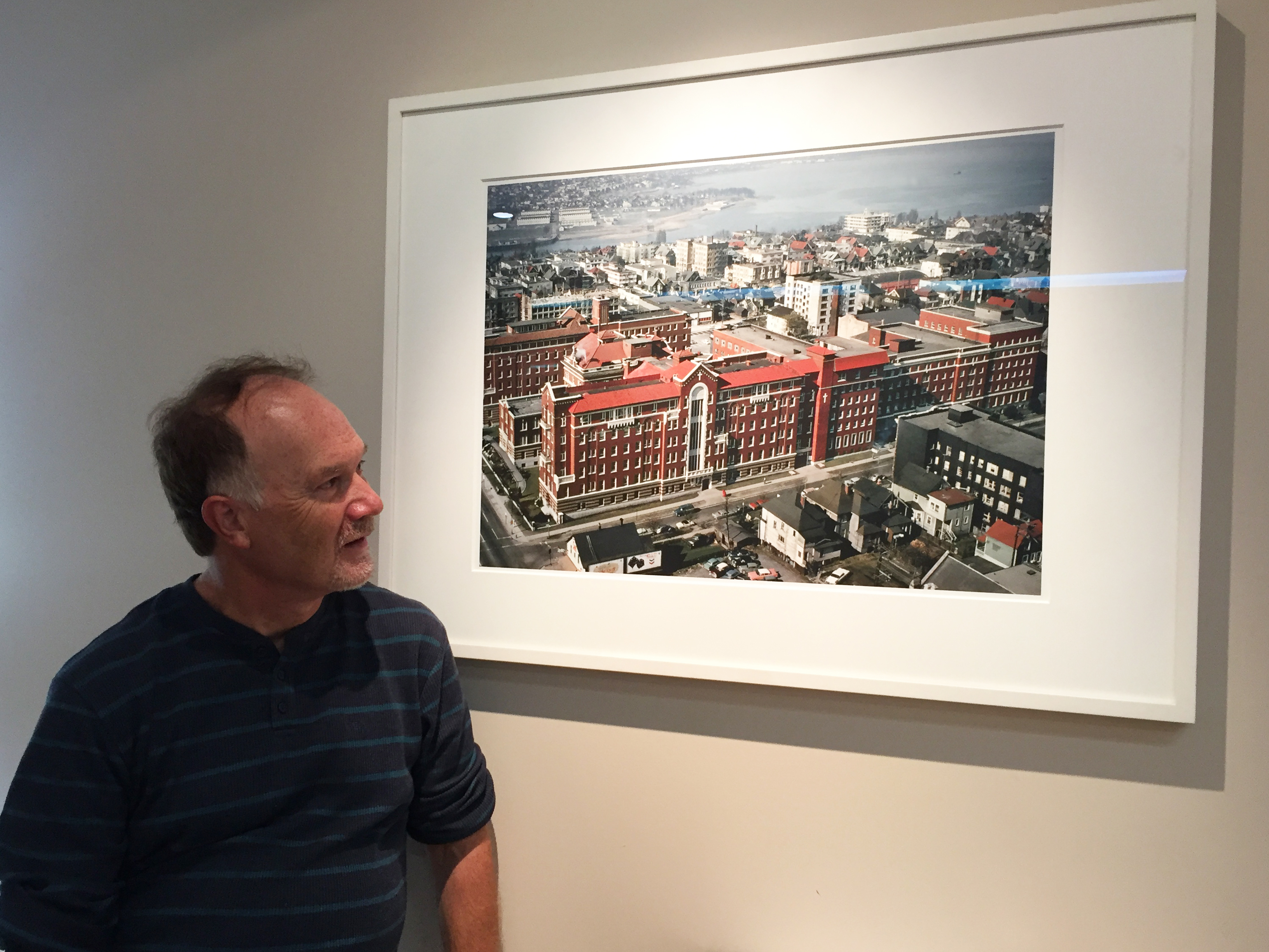 Smith admires the photograph Herzog donated to St. Paul's Hospital.