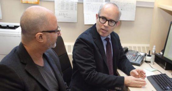 Crosstown Clinic Pharmacy Director Amin Janmohamed talks with Dr. Scott MacDonald.