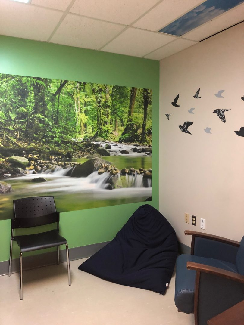 sensory modulation room at St. Paul's Hospital with comfortable chairs and nature mural