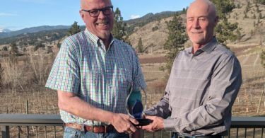 Dr. Jeff Harries, left, with his award and brother, Bruce Harries. (Photo credit: Castanet.net)
