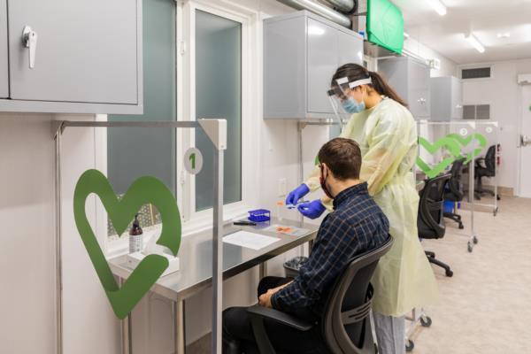 Passenger receiving rapid antigen test at YVR airport