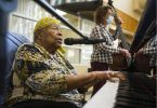 Eve Duke, backed-up by standup bassist Wendy Solloway and drummer Paul Adams, not pictured, plays the grand piano at St. Vincent's Langara care home in Vancouver on June 10. (Photo credit: Vancouver Sun)