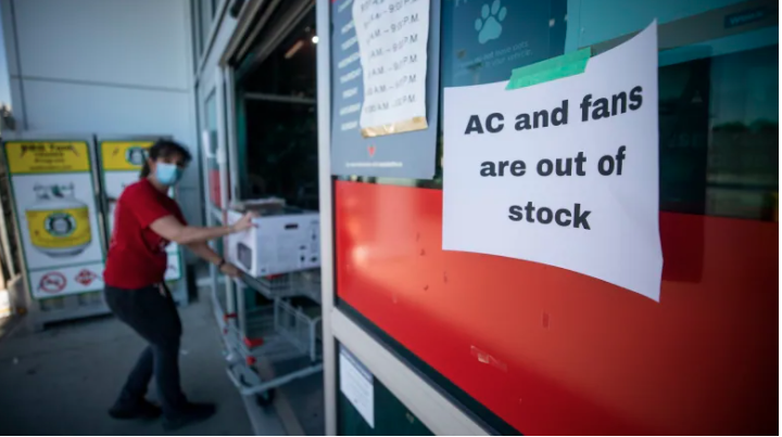 A Canadian Tire store in Vancouver posted a sign advising customers it was sold out of air conditioning units and fans on Monday amid the 'heat dome' that's breaking weather records. (Photo credit: CBC News)