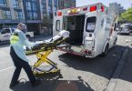 Paramedics respond to an emergency medical call in the 100-block E. Hastings Street in Vancouver. (Photo Credit: Vancouver Sun)